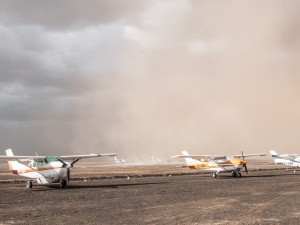 The dust storm engulfs the planes.