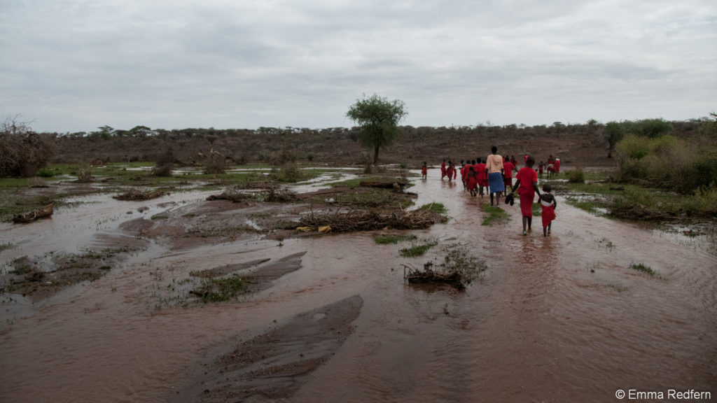 School children crossing flooded ground